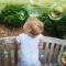 one year old surrounded by bubbles
