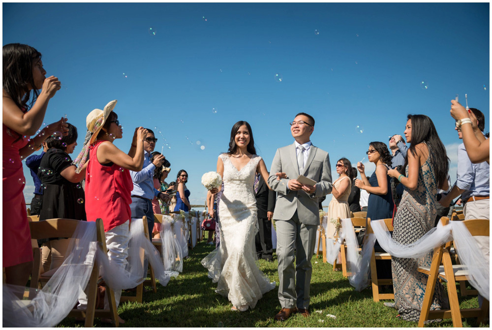 wedding recessional with bubbles at rustic cabin westmoreland state park virgina wedding