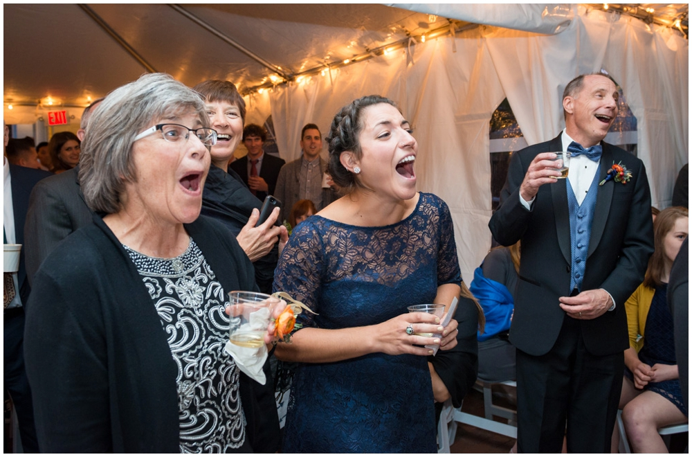 guests reacting to wedding toast