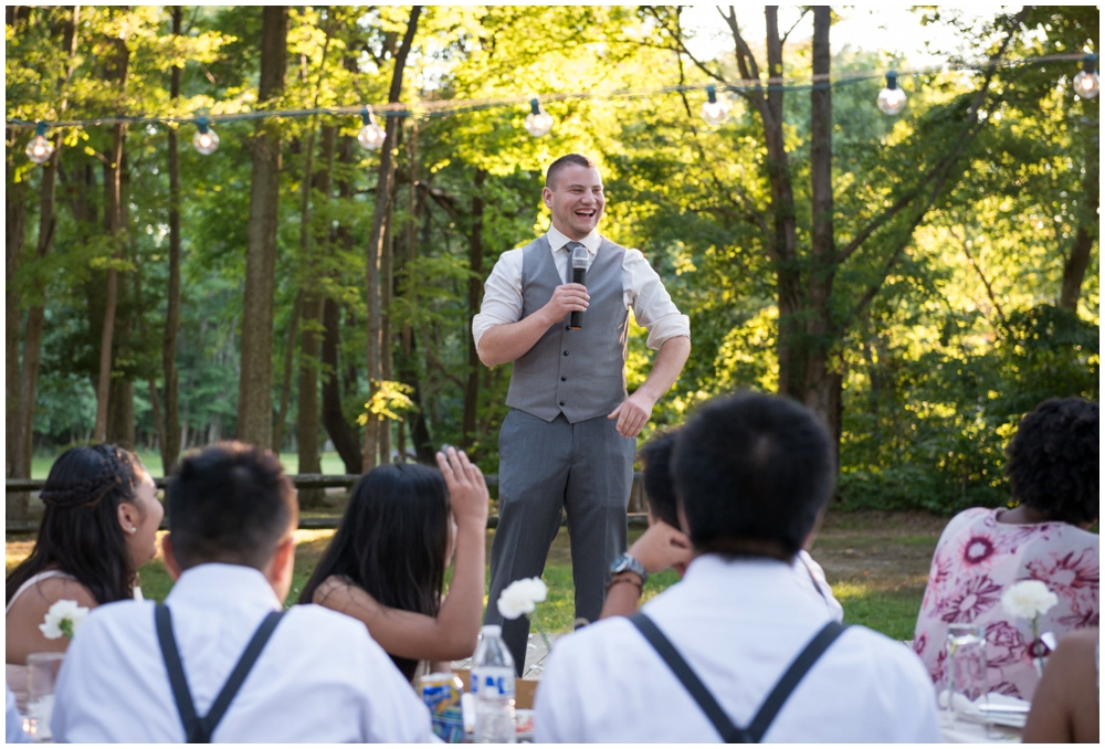 best man giving wedding toast at reception