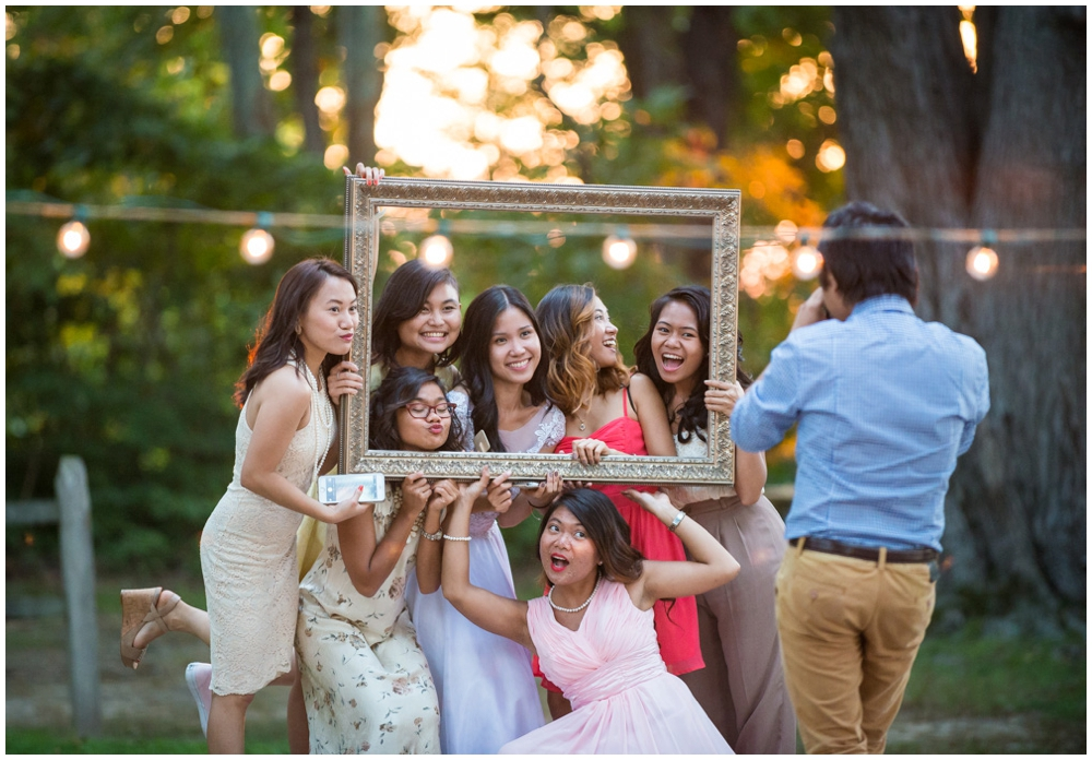 bride taking photos with friends at wedding reception