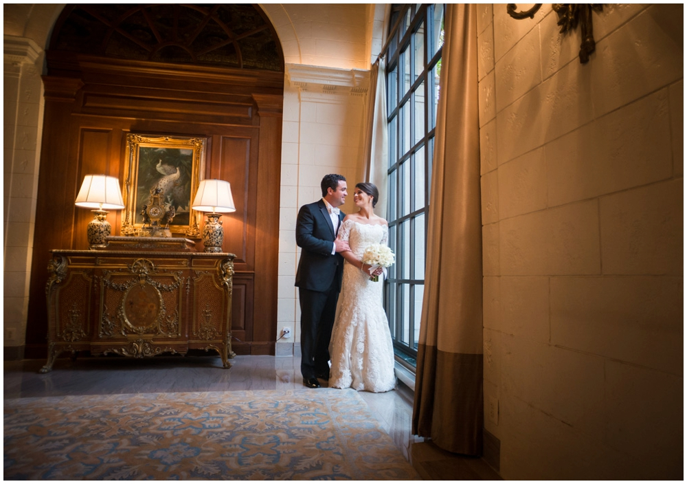 bride and groom portrait in hotel lobby