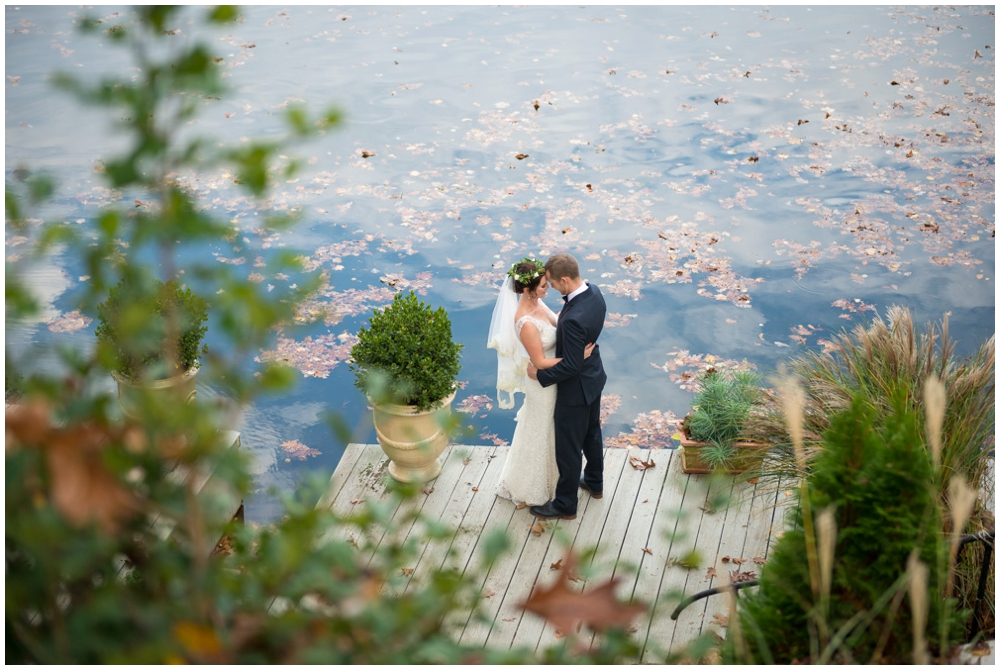 bride and groom portrait by lake