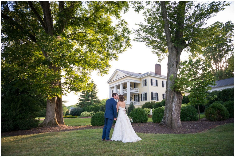 bride and groom portrait in front of manor house