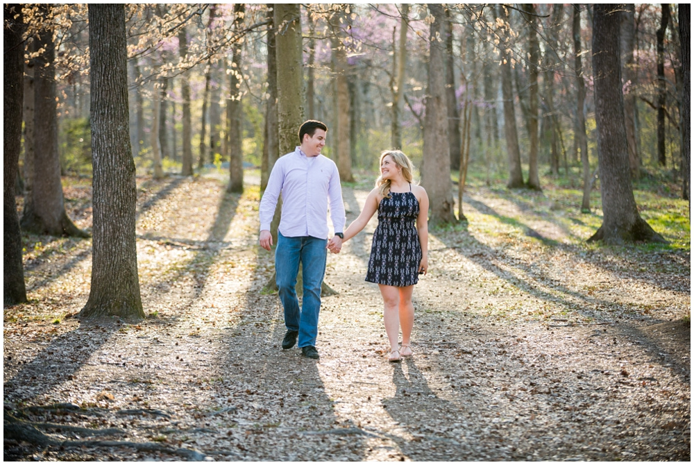 engaged couple at park with trees