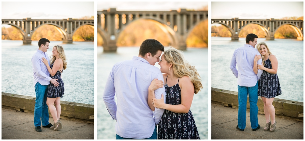 engaged couple near river and bridge