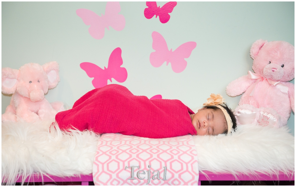 portrait of newborn baby girl with pink butterflies and flowers