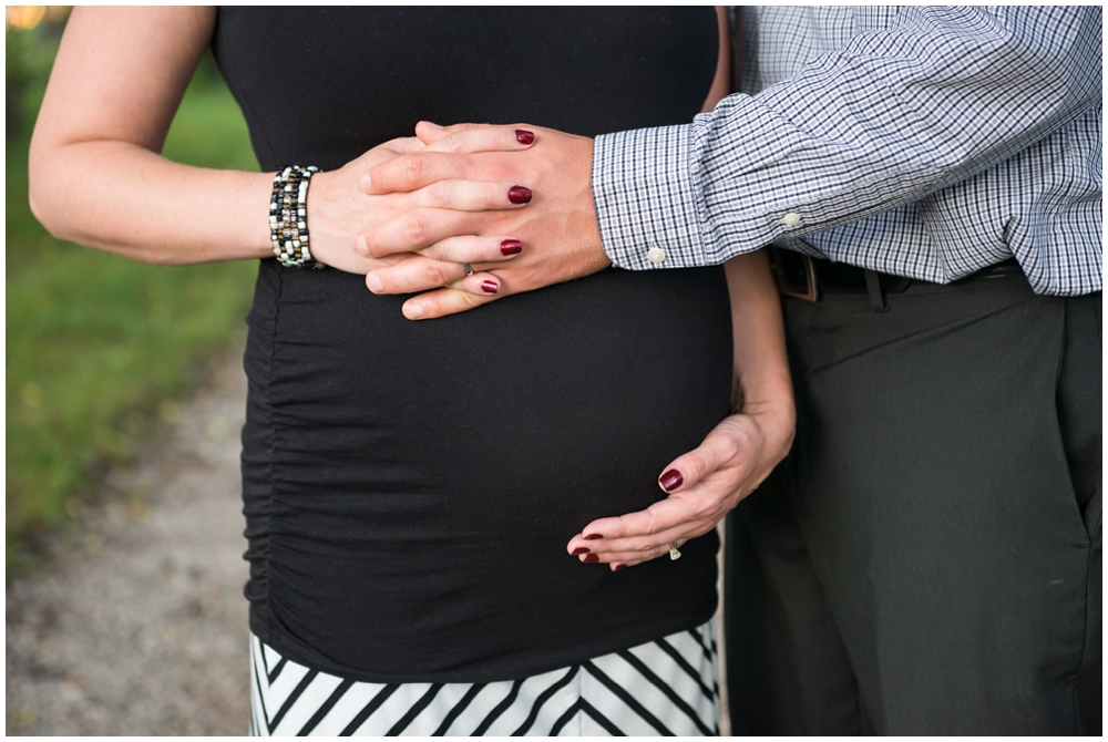pregnant belly with clasped hands