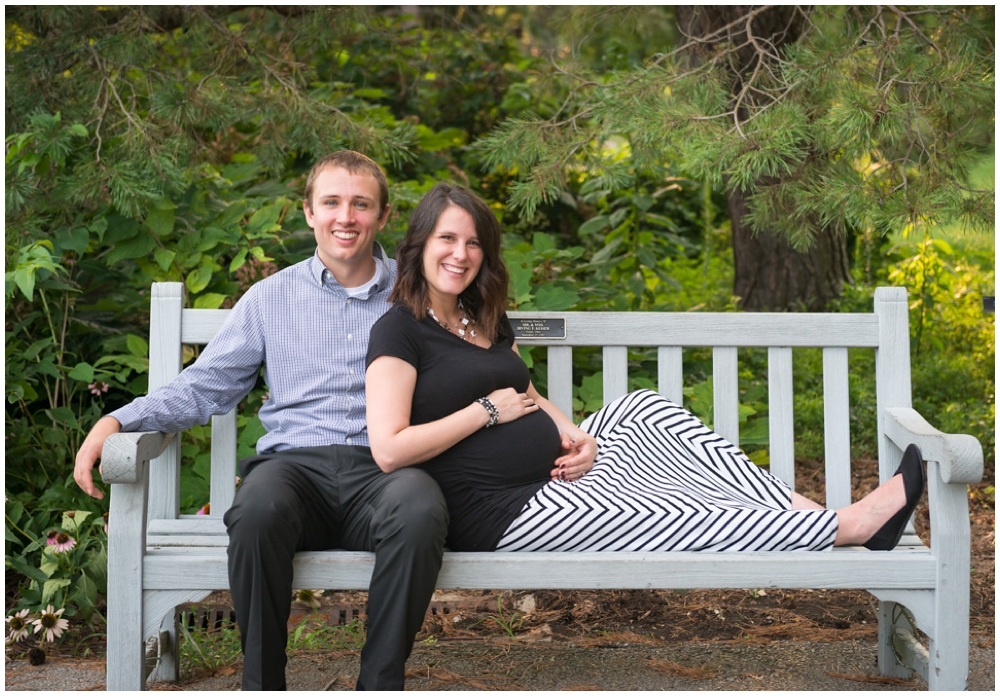 pregnant couple in park on bench