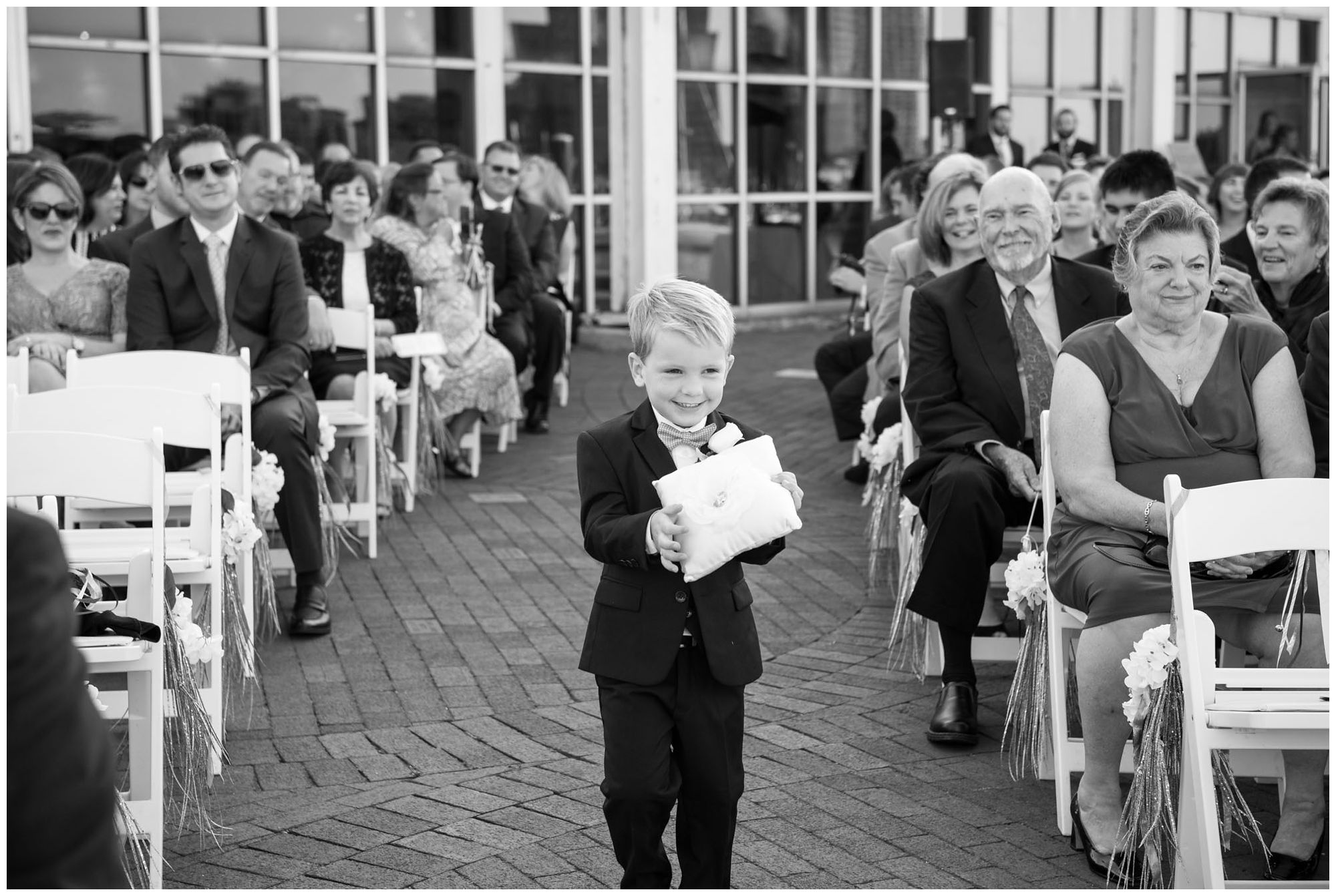 Ring bearer in harbor wedding at Baltimore Museum of Industry