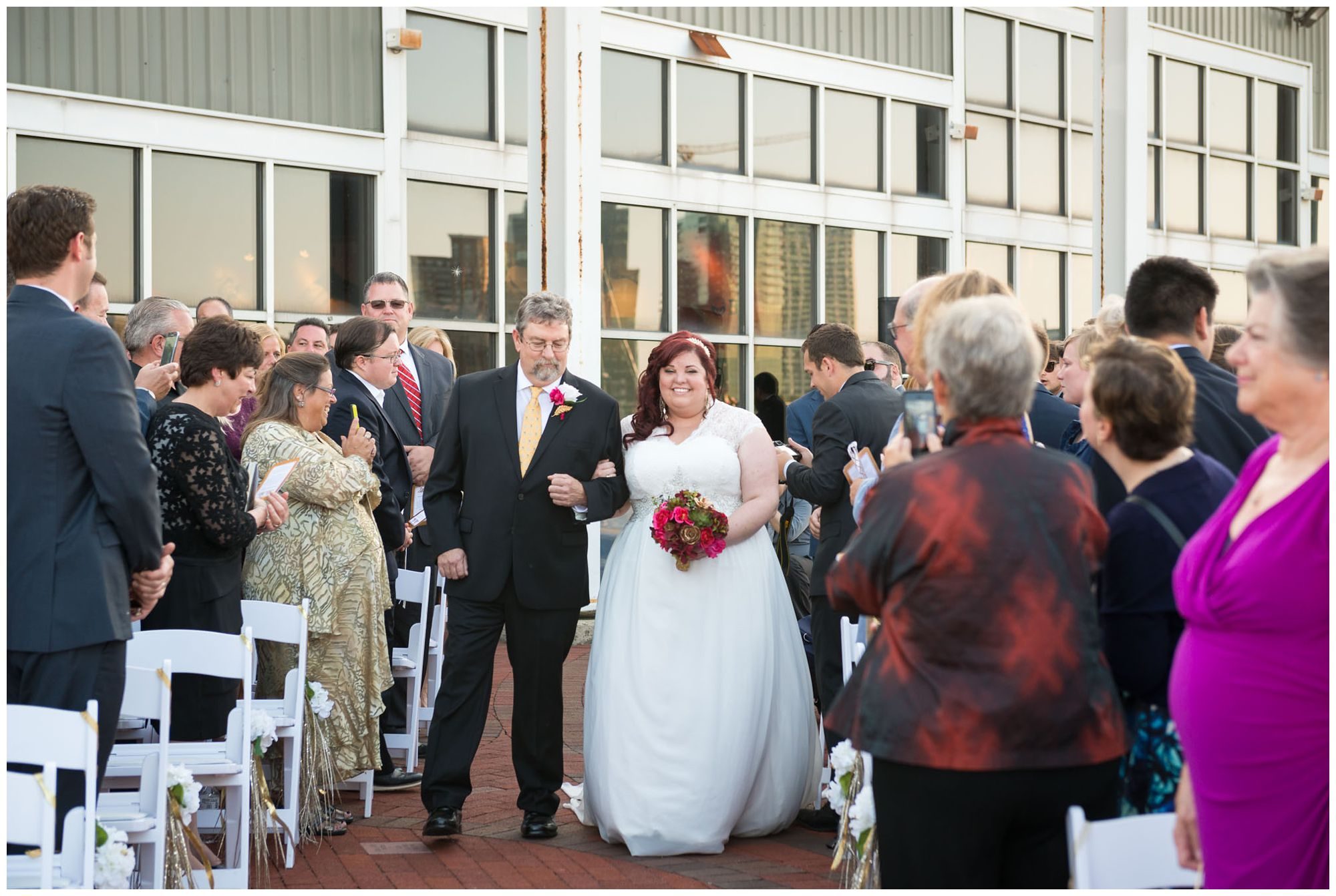 Bride entering with dad during harbor wedding at Baltimore Museum of Industry