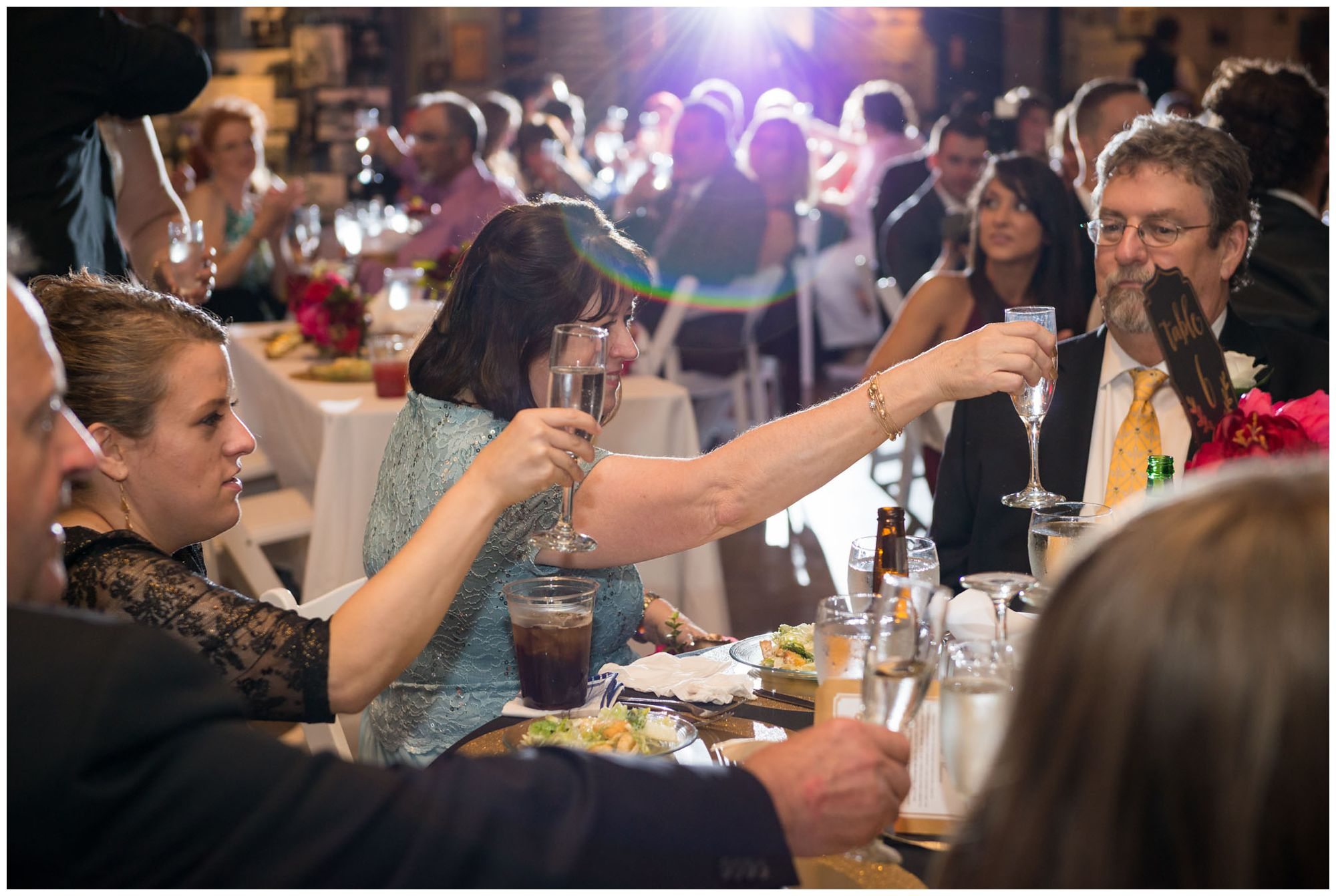 Toasts during wedding reception at Baltimore Museum of Industry