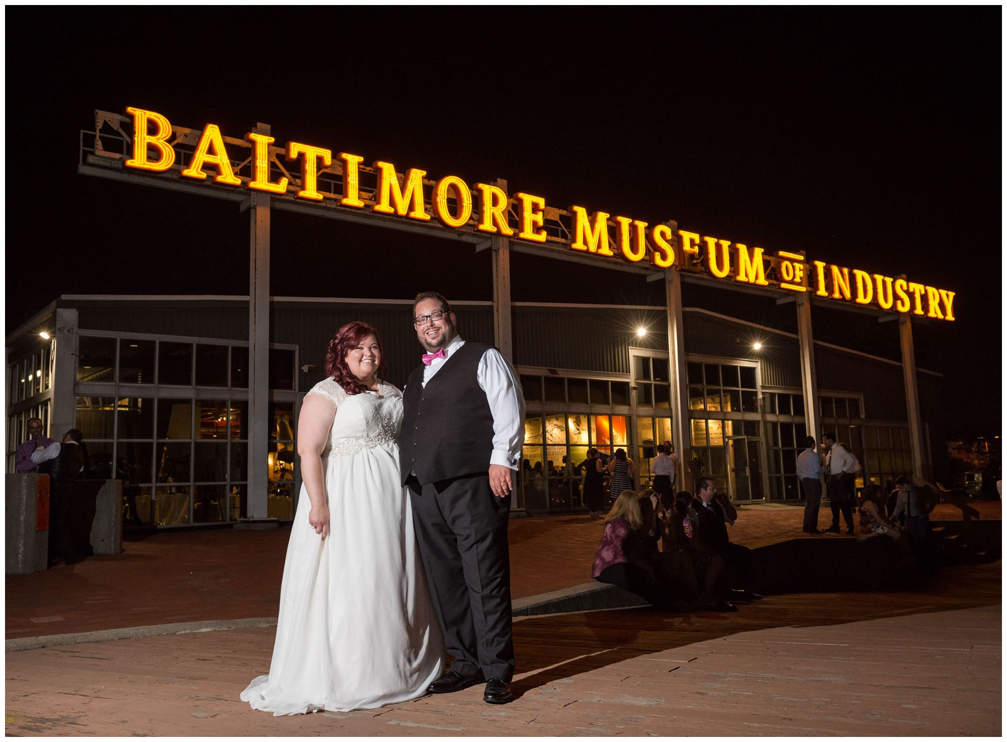 Bride and groom at nighttime in front of Baltimore Museum of Industry