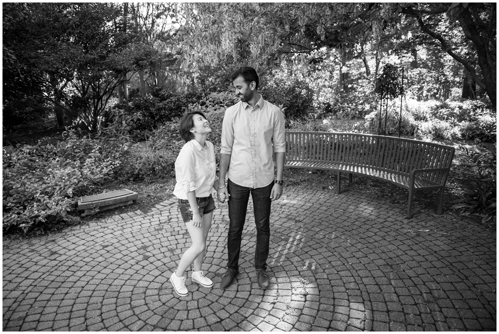 Engaged couple laughing at Green Spring Gardens in Alexandria, Virginia