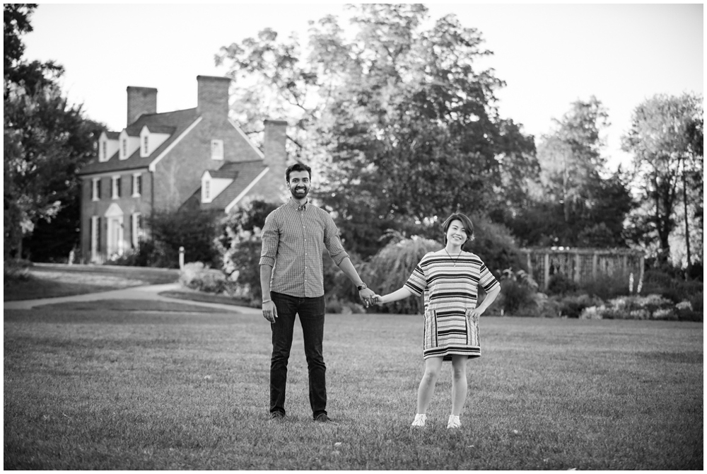 Engaged couple portrait in front of historic manor house at Green Spring Gardens in Alexandria, Virginia
