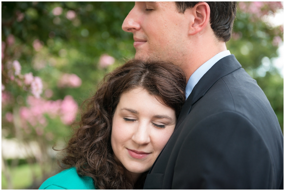 closup of engaged couple hugging