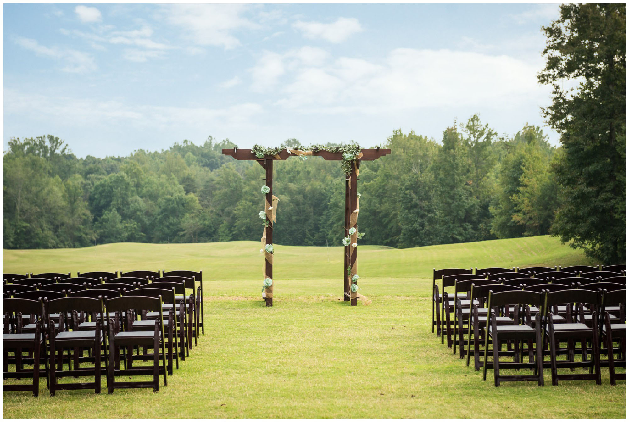 wedding ceremony setup with arch at golf club