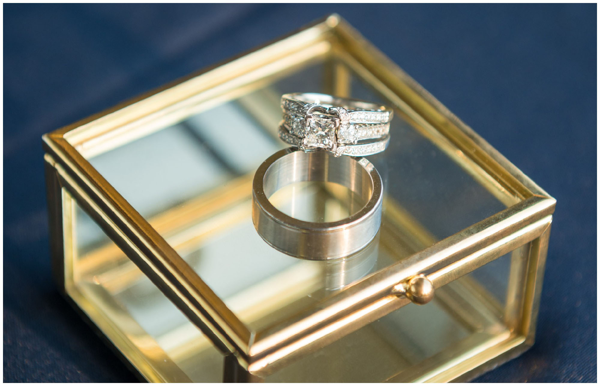 wedding rings on gold mirrored box