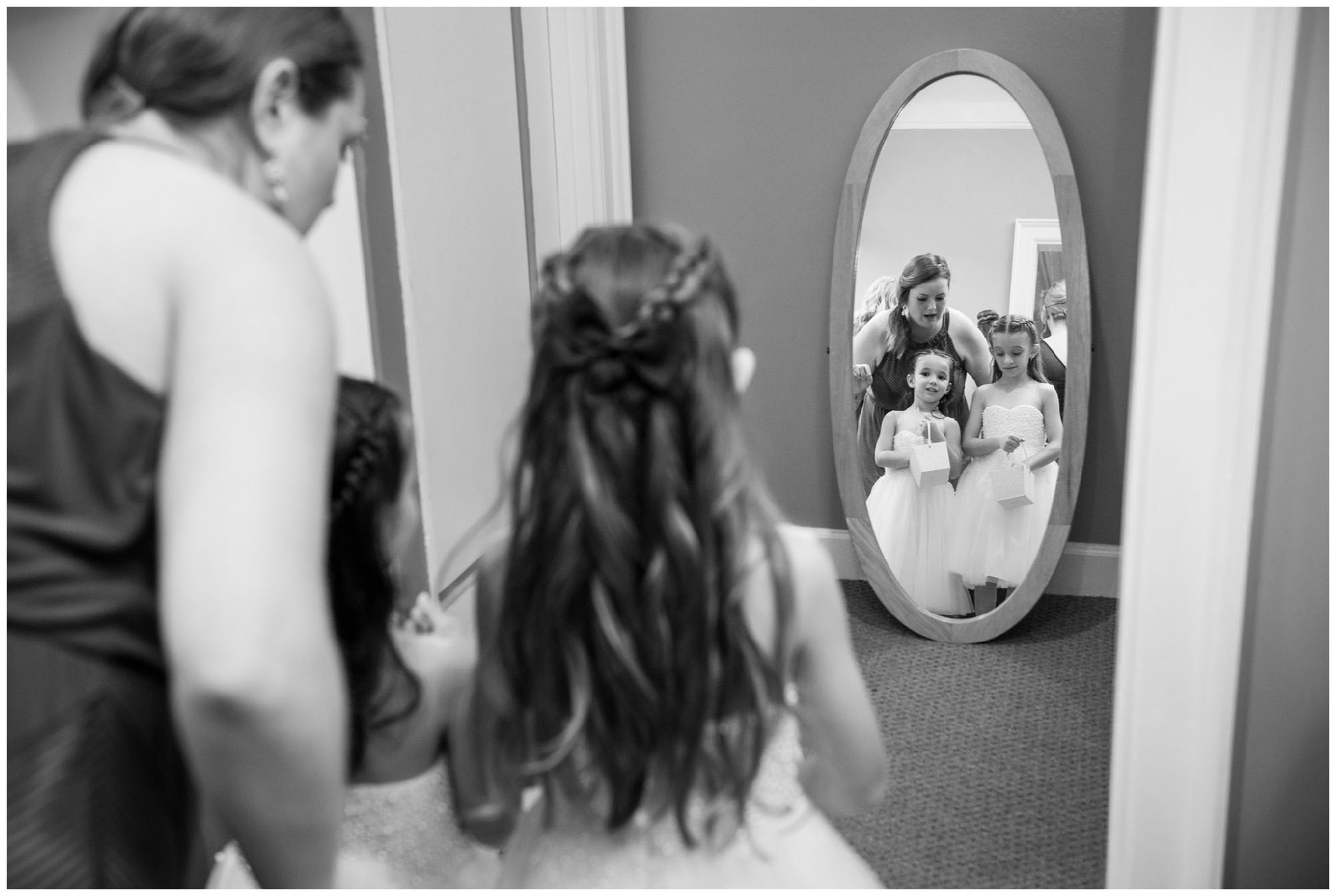 flower girls getting ready in mirror