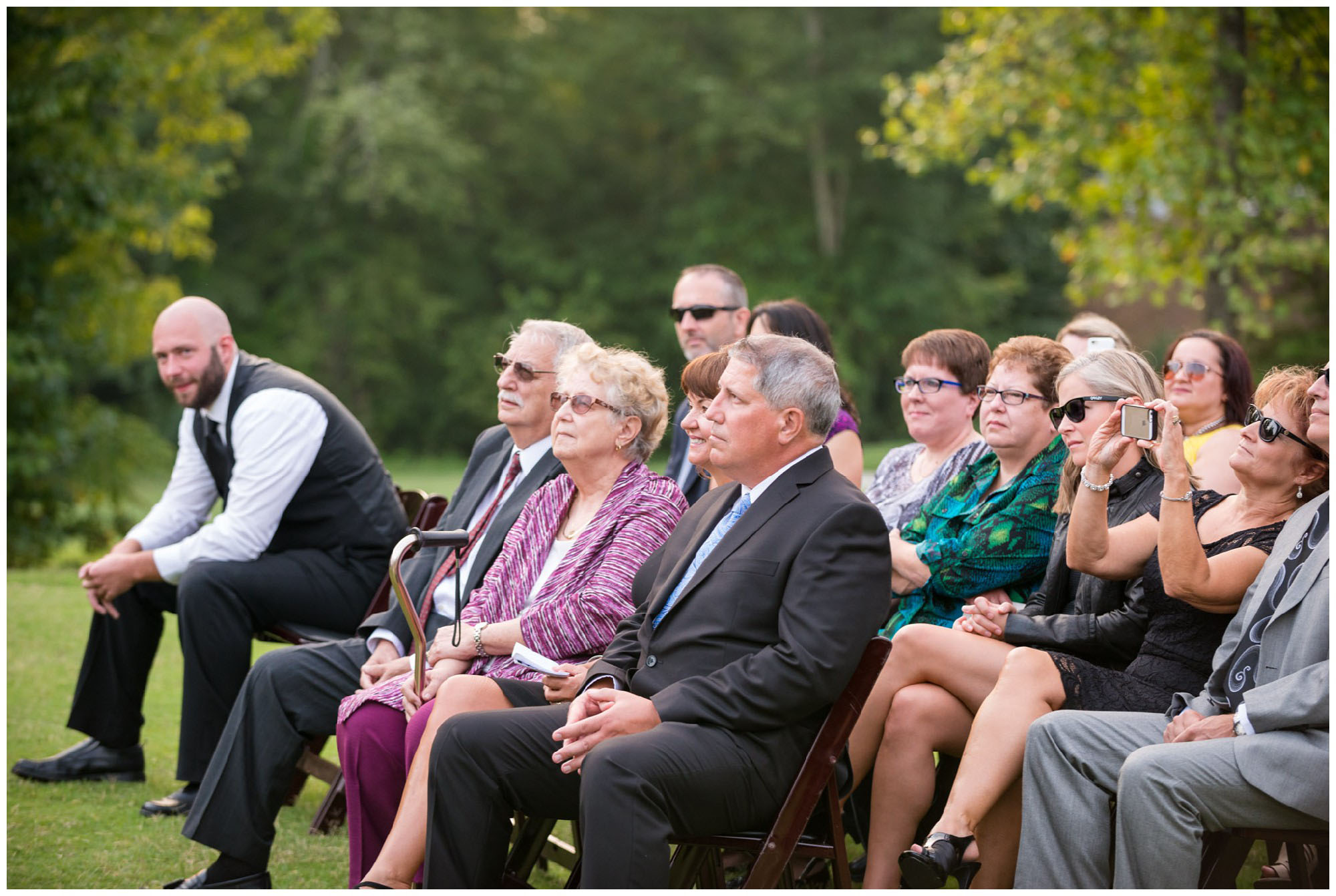 family and friends watching wedding ceremony