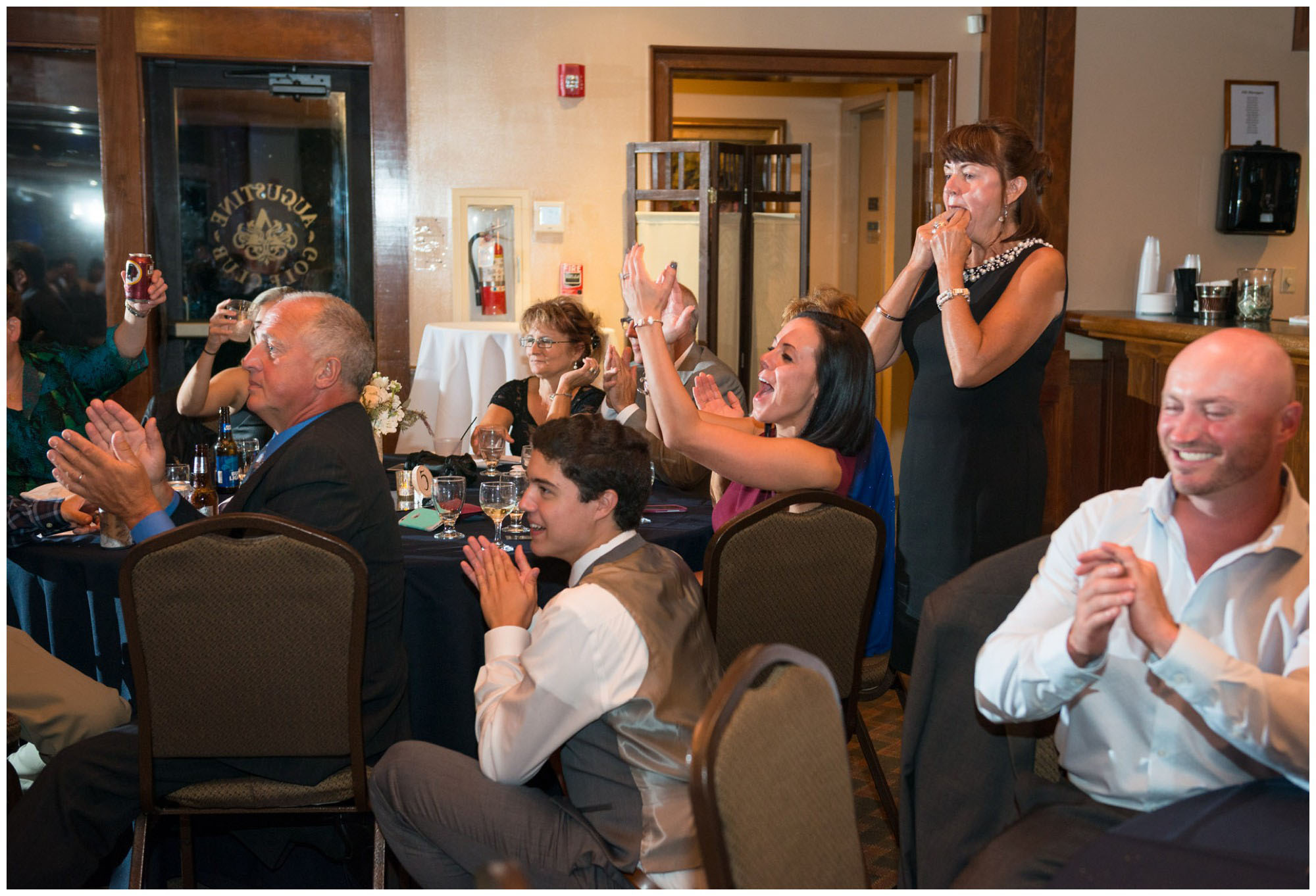 guests react to toasts at wedding reception