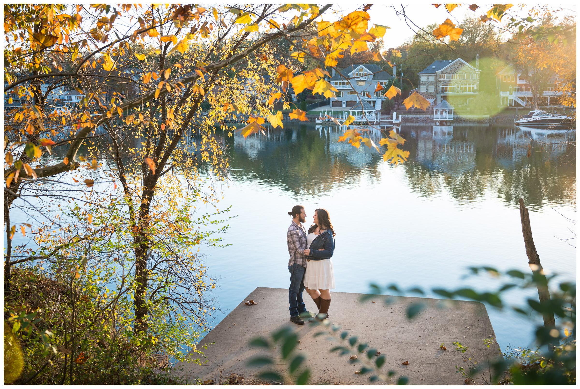 engaged couple near river in Virginia