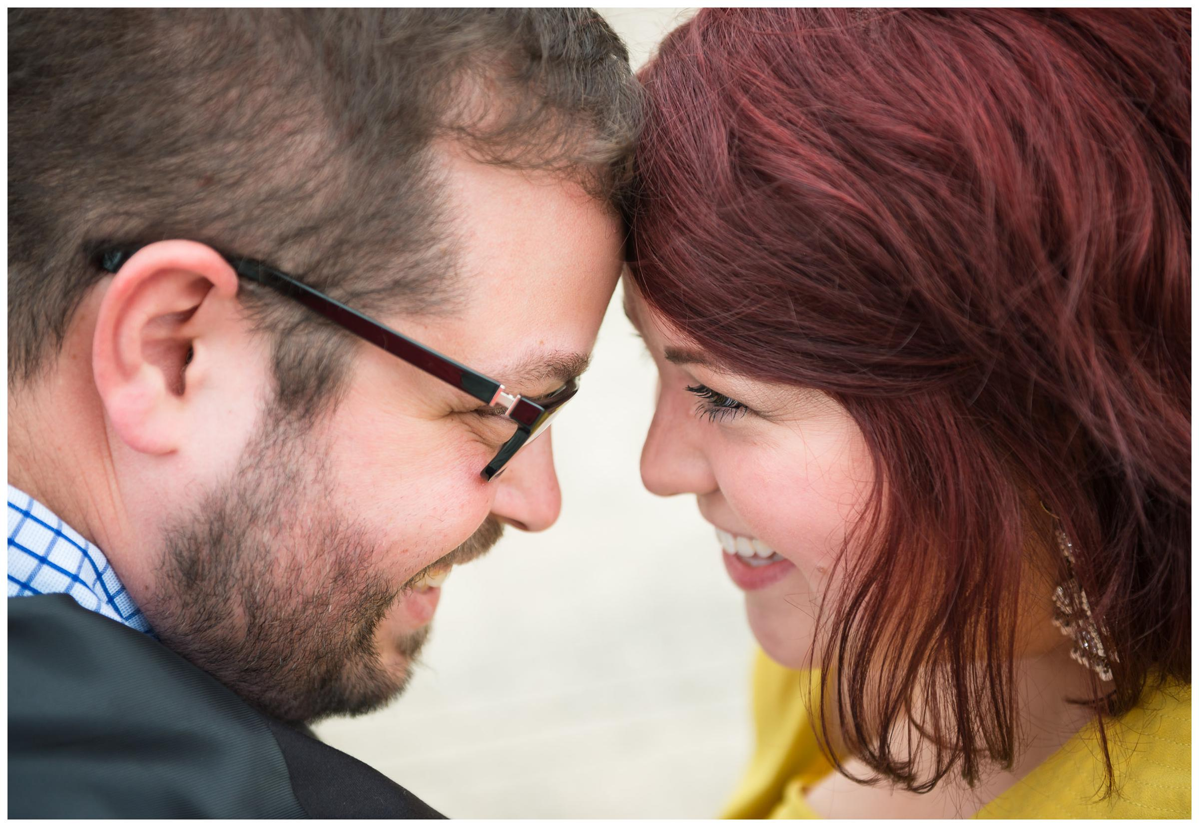 closeup of engaged couple forehead to forehead
