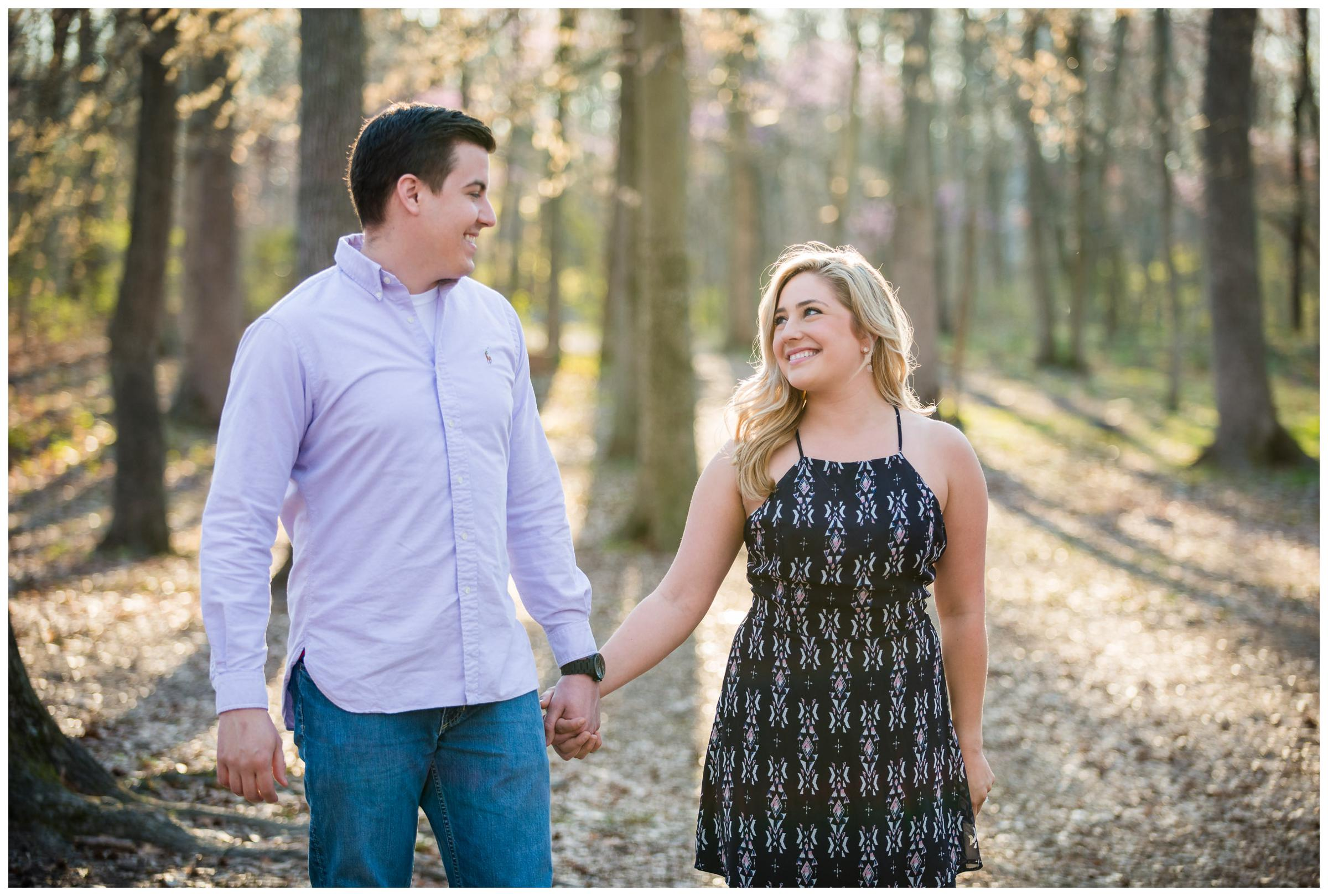 engaged couple in forrest