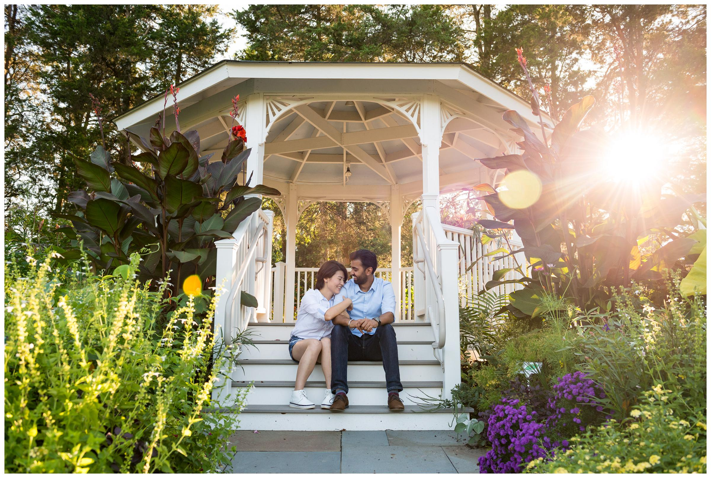 engaged couple in gazebo with sun flare