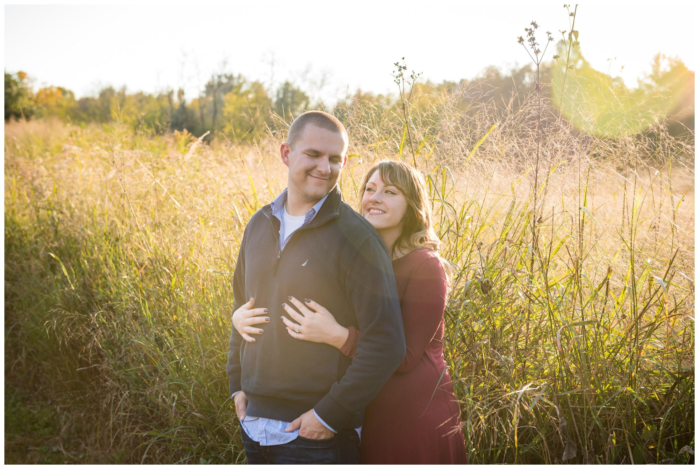 golden hour engagement session in field