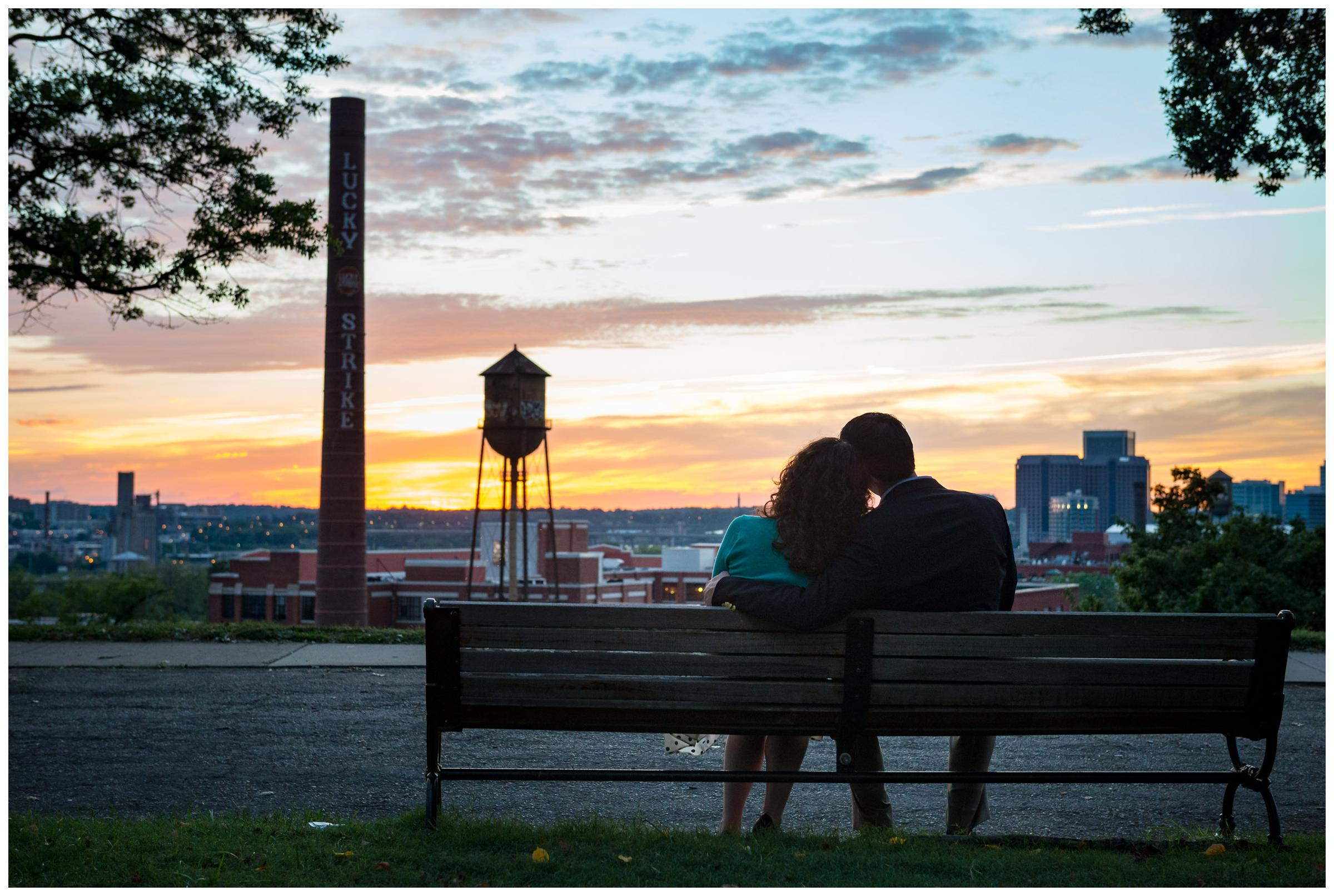 engaged couple on bench at sunset in Richmond Virginia