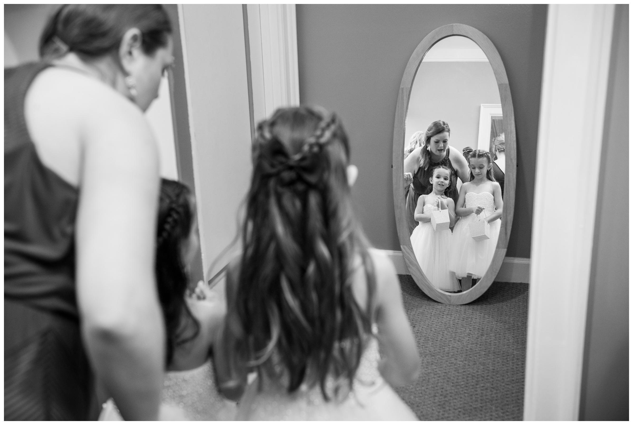 flower girls getting ready before wedding ceremony