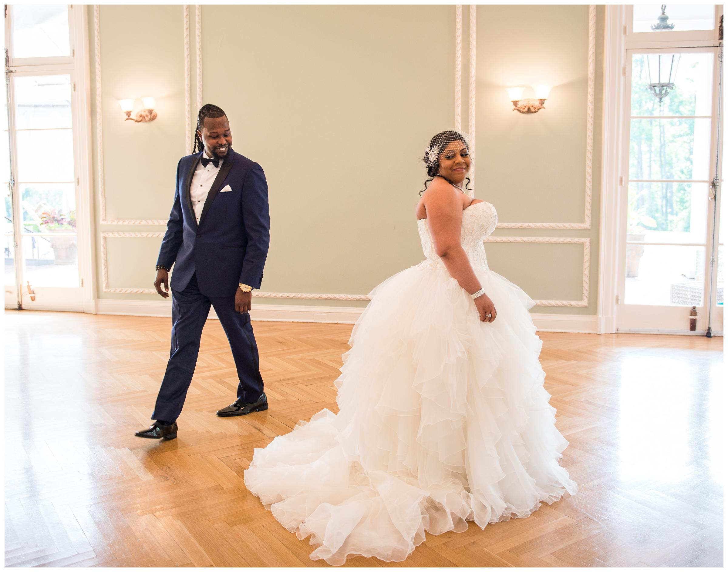 bride and groom showing excitement during first look at Oxon Hill Manor in Maryland