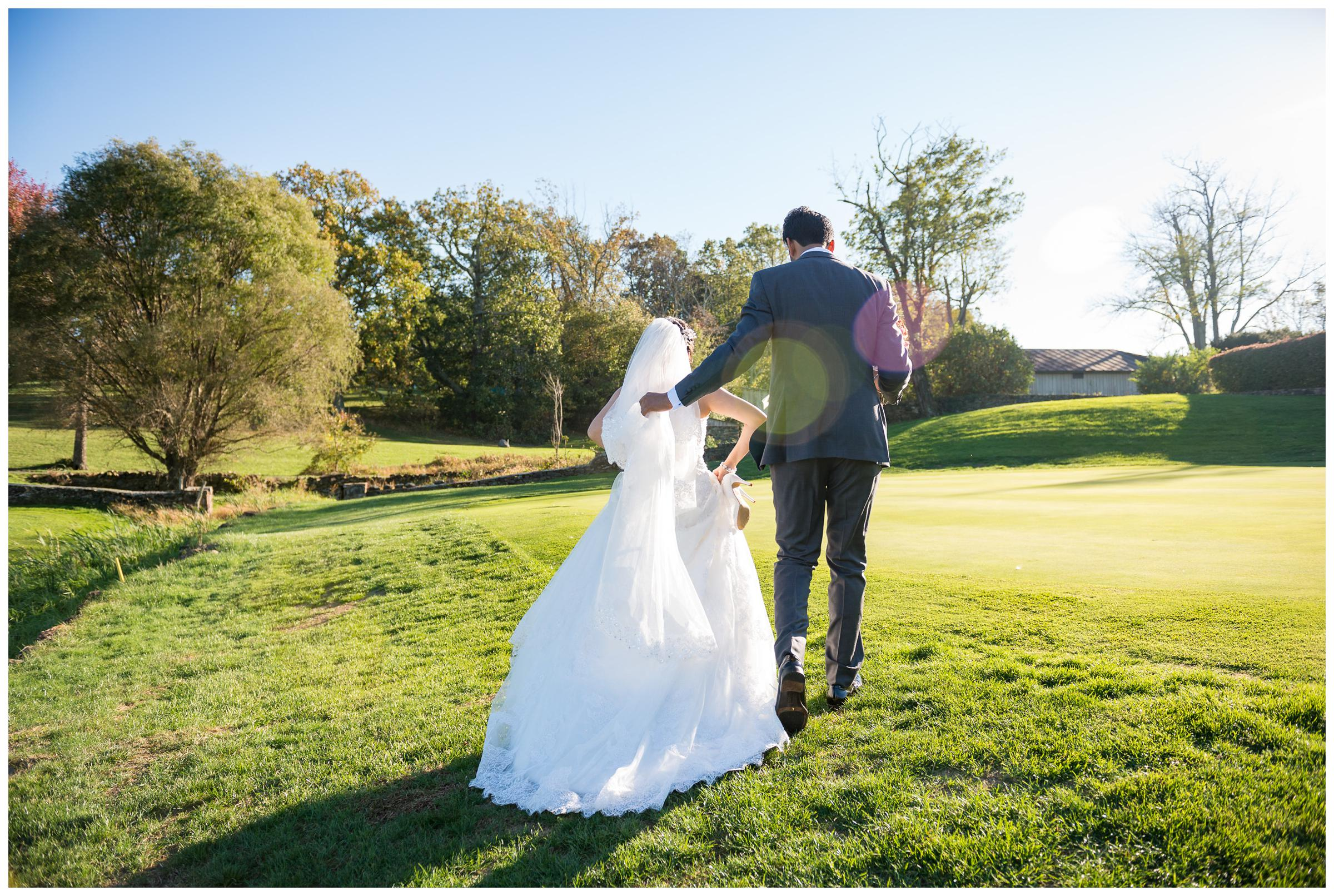 bride and groom walking at Stoneleigh Golf and Country Club in Virginia