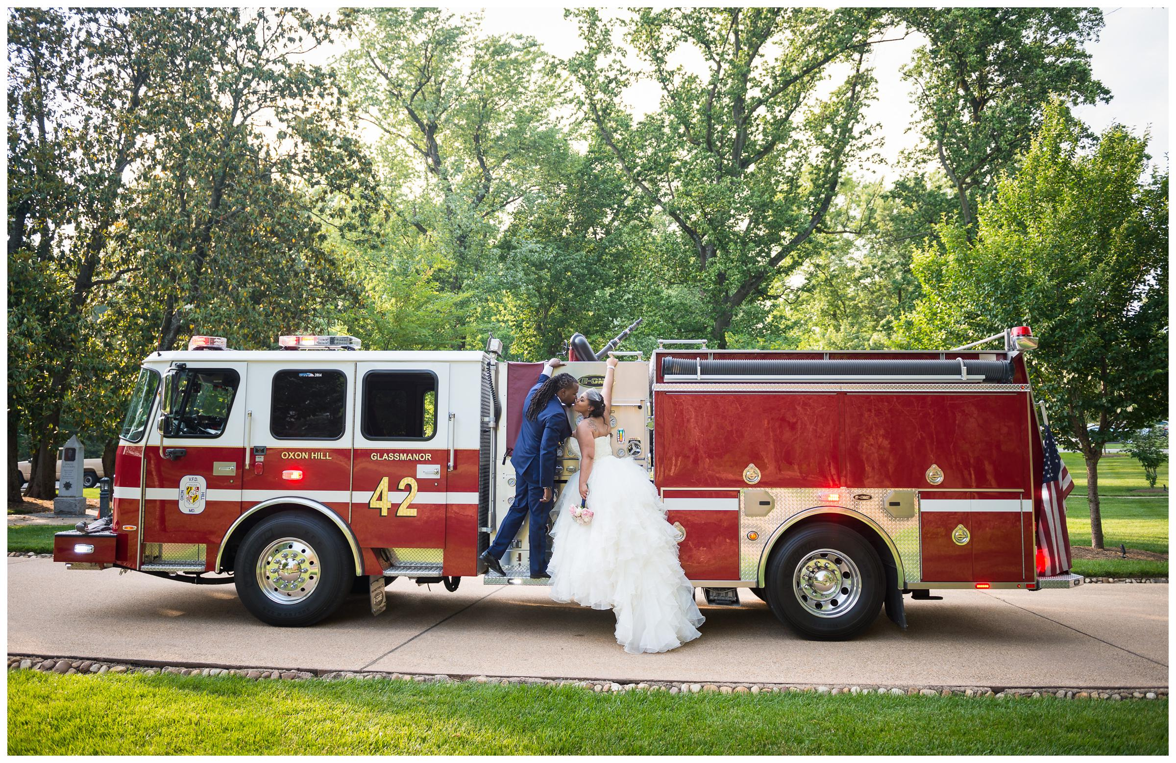 bride and groom portrait on fire truck