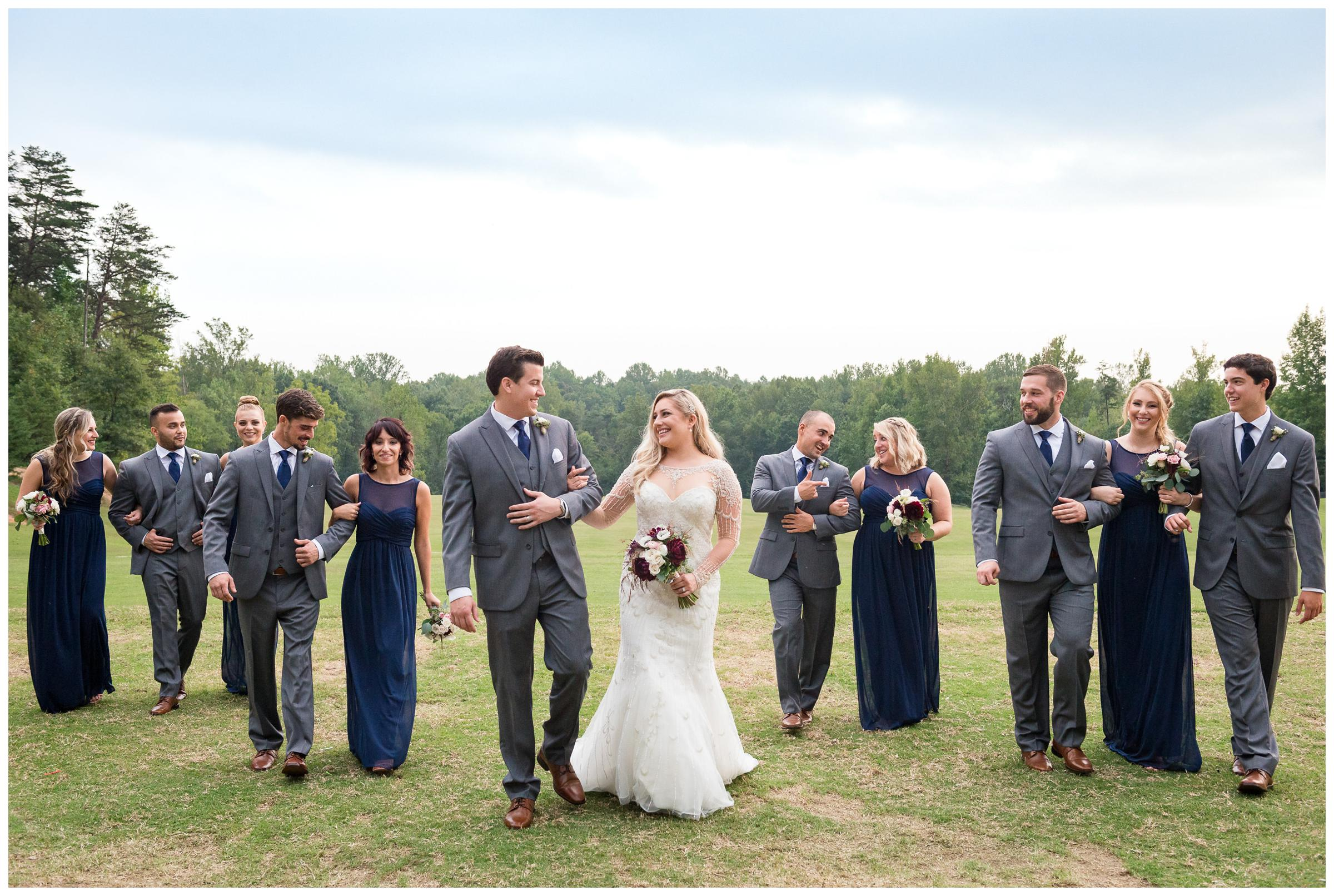 bridal party staggered walking in field
