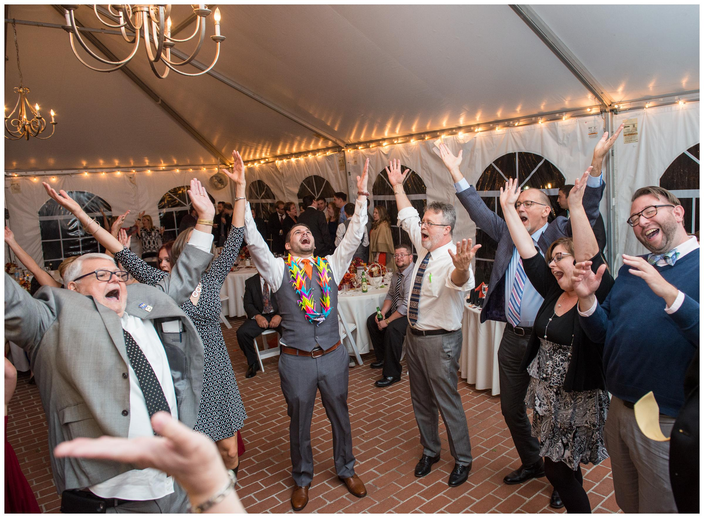 guests dance to the YMCA at tented wedding reception