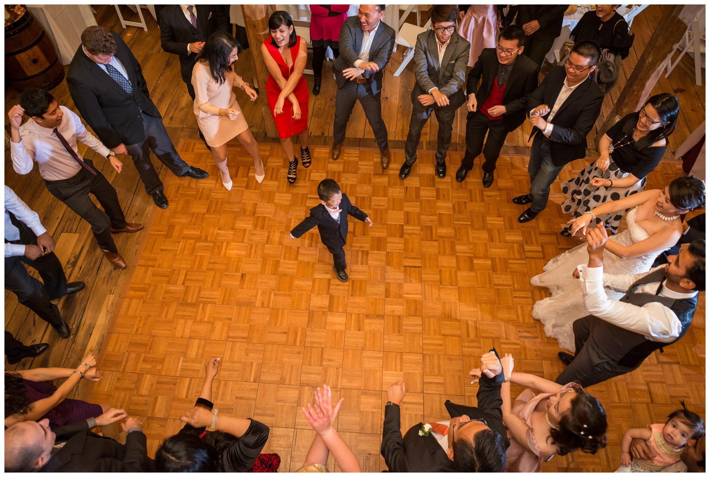 child dancing in circle during wedding reception at Stoneleigh Golf and Country Club in Virginia