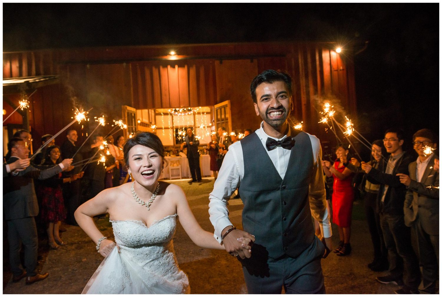 bride and groom sparkler exit from barn