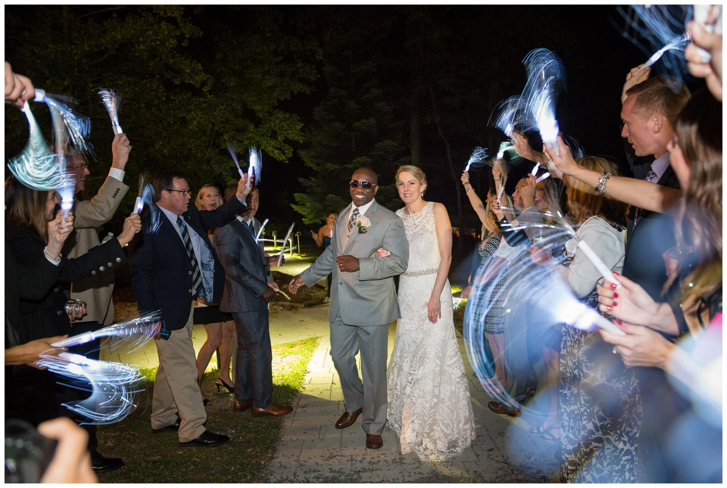 bride and groom during glow stick reception exit