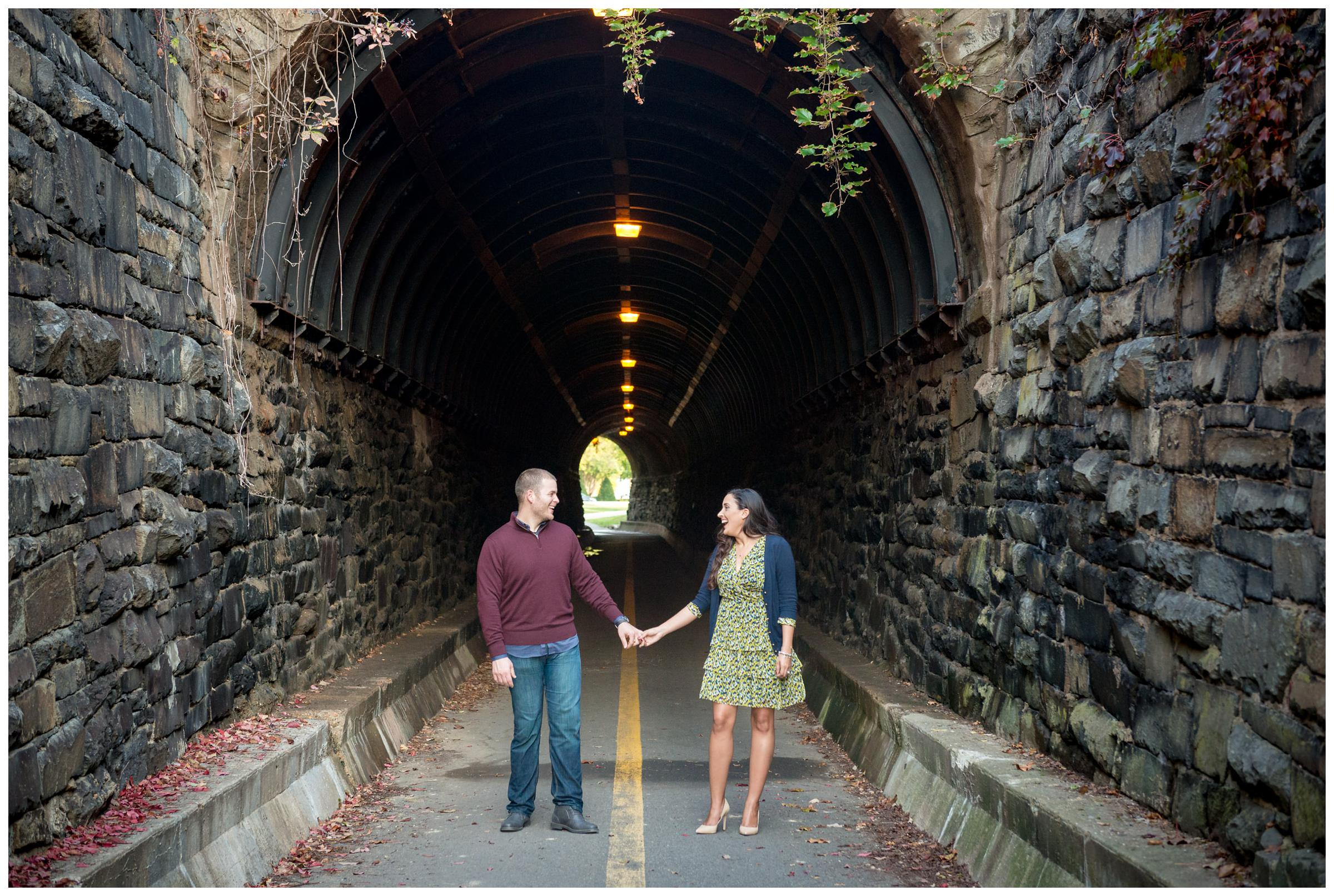 engaged couple at Wilkes Street pedestrian tunnel in Old Town Alexandria, Virginia