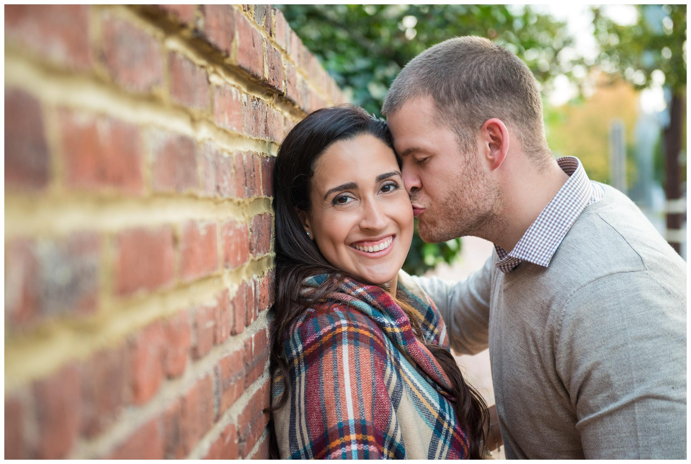 Old Town Alexandria engagement session along brick wall