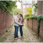 engaged couple in cobblestone alleyway in Old Town Alexandria, Virginia.