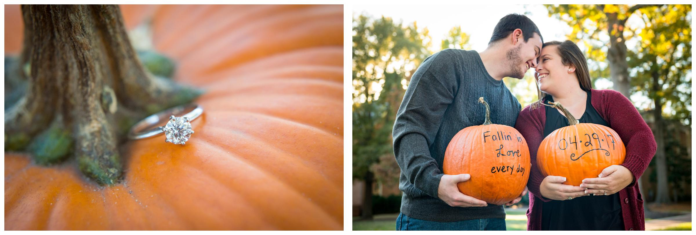 Engaged couple holding pumpkins with wedding date written on them.
