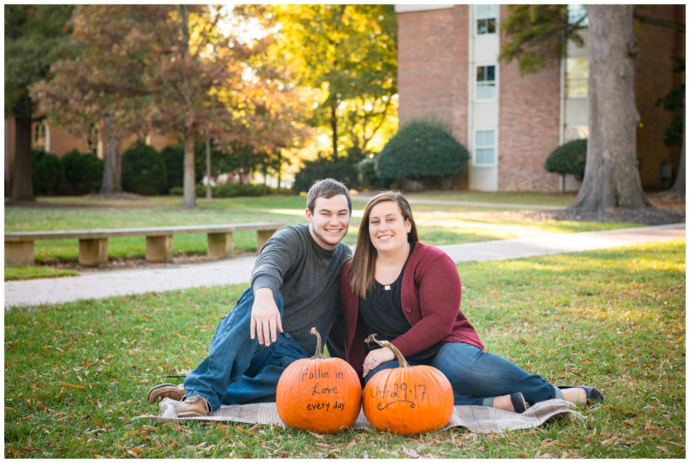 Fall engagement photos with pumpkins.