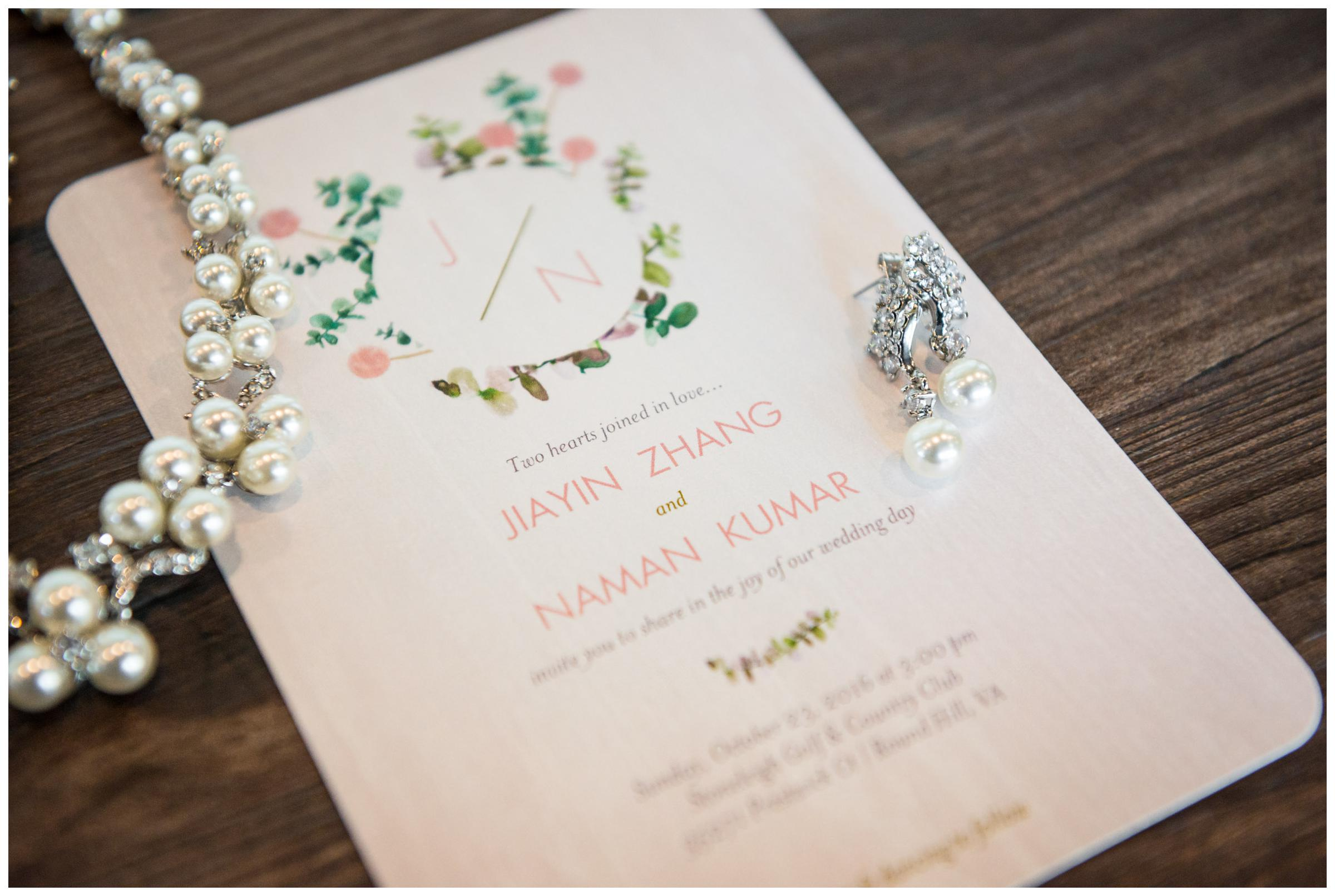 rustic wedding invitation with bride's jewelry
