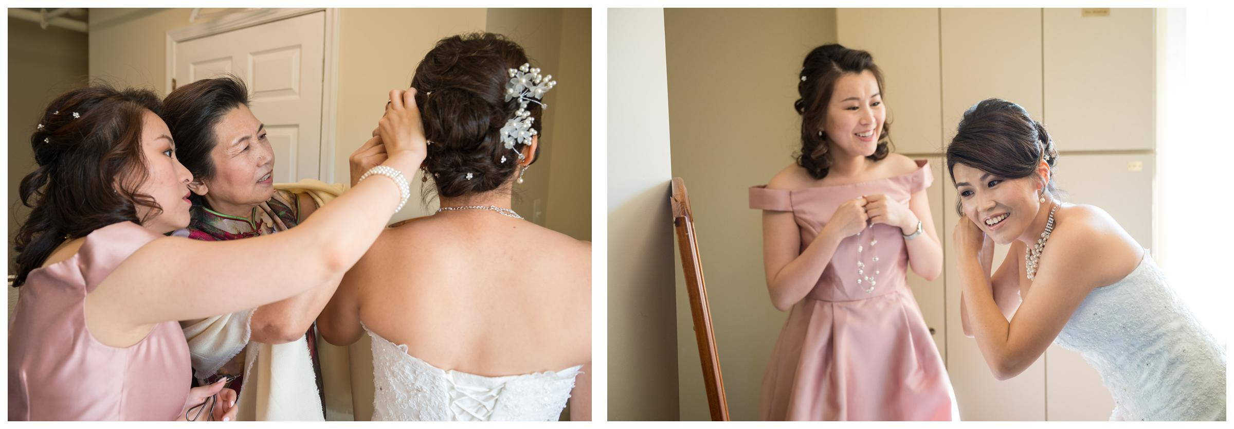 Bride getting dressed with bridesmaid and mom before wedding ceremony.