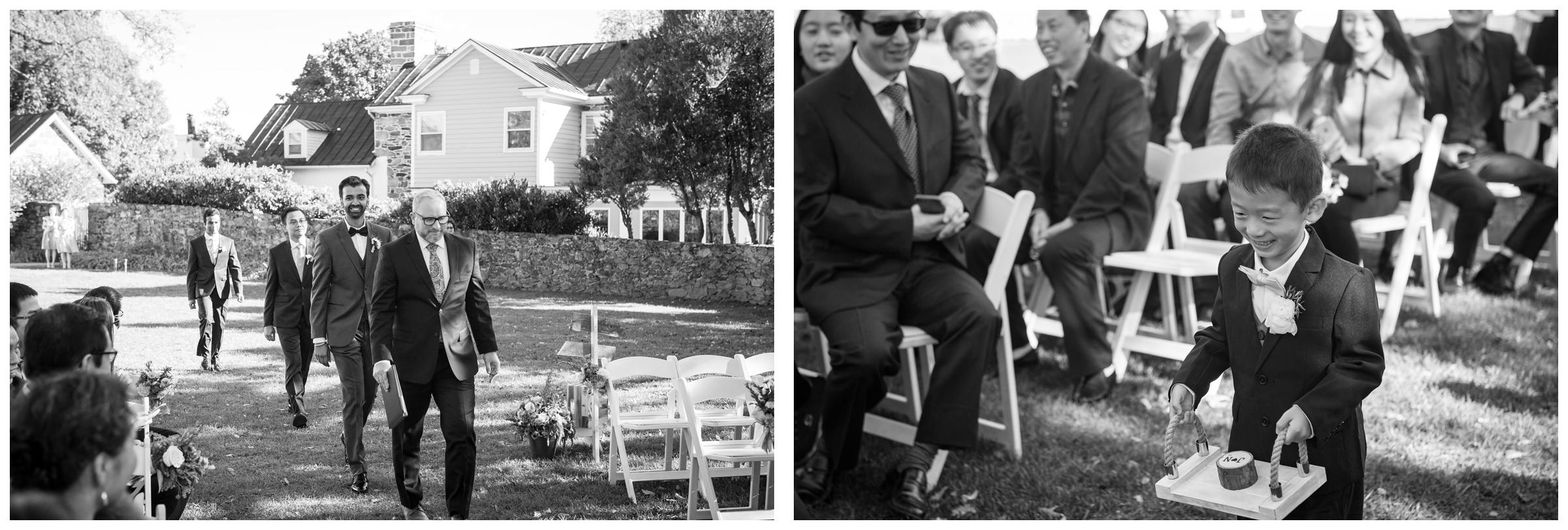 Groomsmen and ring bearer entrance during outdoor wedding ceremony.