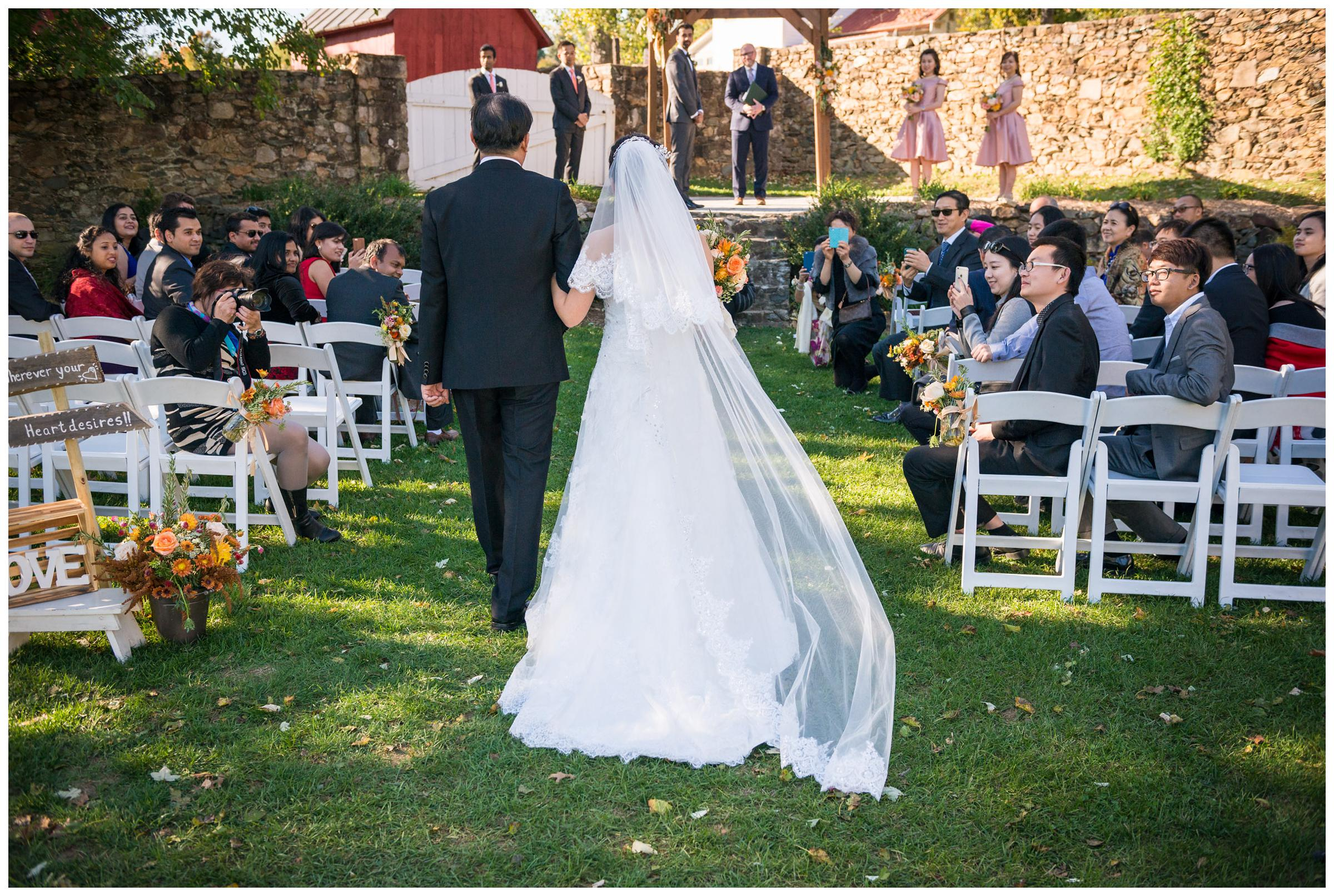 Bride escorted down the aisle by her father.