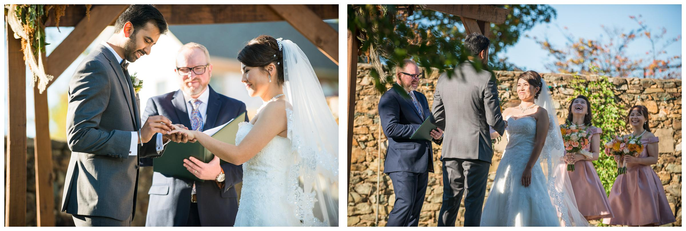 Bride laughing and couple exchanging rings during rustic wedding ceremony in Virginia.